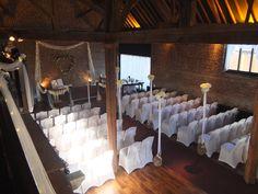 Unusual aisle arrangements in the Fathom Barn by Danny Watchorn Designer Florist.