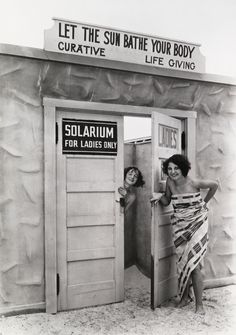 """Bathing beauties emerge from a solarium"""" (a tanning booth), in St. Petersburg, Florida, June 1929.Photograph by Clifton R. Adams, National Geographic"""