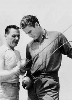 Errol Flynn with a fencing instructor