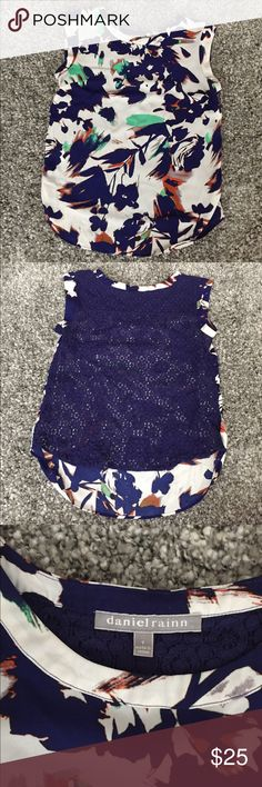 Sleeveless Floral Shell with Lace Back Perfect addition to your Spring wardrobe! Can easily dress up or down. Abstract floral pattern with open Lace back. Runs true to size. Fashion footwear buyer by day, Poshmark purveyor by night! All items ship via USPS within 2 business days. Daniel Rainn Tops Blouses