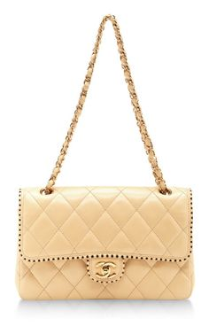 Vintage Chanel Cream Half Flap Two-Tone Trim Lambskin Bag by What Goes Around Comes Around for Preorder on Moda Operandi