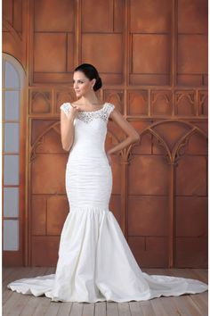 The Trinity gown is absolutely gorgeous from the front and back. The entire gown is made of beautiful taffeta and lace and hugs every curve on the body. Delicate cap sleeves add a soft and delicate detail. This is a great option for spring and summer ceremonies on a beautiful beach or in a lush garden.