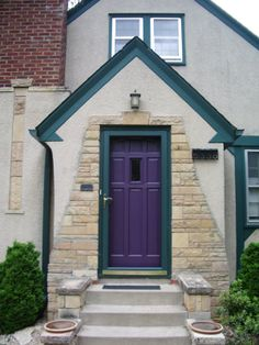 purple front door with gray house and green trim! Color combo