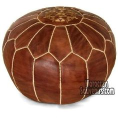 "Stuffed Moroccan Pouf, Pouffe, Ottoman, Poof, Color : Brown #pouf This a beautiful Moroccan pouf made out of Natural Genuine leather, it's been handcrafted in Marrakesh (Morocco), it comes stuffed with shredded foam using a fabric liner, it will definitely add a beautiful touch to your place. 100% Genuine Leather. Measurement : Diameter : 20"" Height : 12 #homeandgarden"