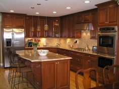This kitchen is so beautiful..I love the dark cabinets.