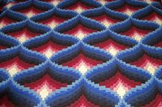 Close up view of Light in the Valley quilt is reminiscent of a three-dimensional image