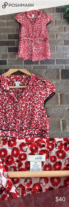 Odille Silk Poppy Half Peplum Blouse Made from silk, this short sleeve top by Odille is great for dressing up or for the office. The peplum cut really makes the piece. In great condition. Approximate measurements lying flat: 19' bust, 15' waist (unstretched), 24' length 10655 Anthropologie Tops Blouses
