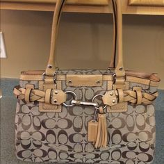 Coach canvas satchel Coach canvas satchel with leather braided accent.  Has partial zip closure, inside there are 3 pockets one zip the other two are for cell phone/keys.  Love this bag and never use just not big enough for me... Have 4yr old twins...enough said Coach Bags Satchels