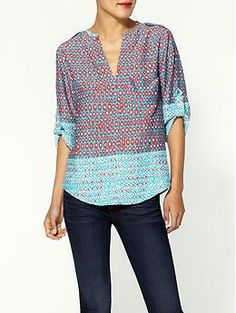 Super cute border print top with the rolled sleeves. Such a laid back top to wear any time!