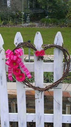 simple grapevine heart wreath, added a bow and some pink flowers. Made the wreath from grapevine in backyard .