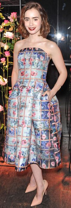 Lily Collins in a printed strapless gown
