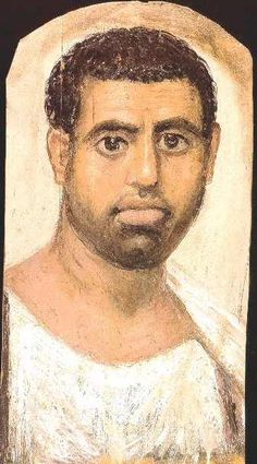 A Graeco--Roman period portrait on a mummy. In the realistic style of the Graeco-Romans, it is clear to see what an Egyptian looked like. (A Greek or Roman occupier would not have been mummified, but follow their own burial techniques).
