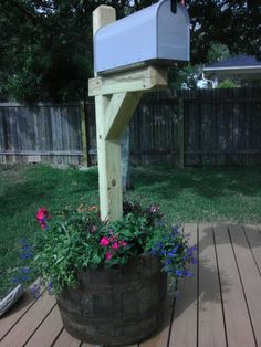 Whiskey barrel, mailbox, pre-made mailbox post. Hubby made a stand, I added dirt & flowers!