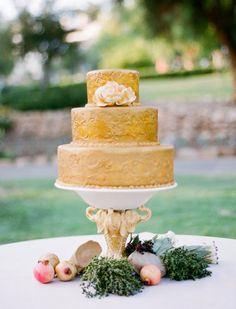 a golden cake Photography by Lacie Hansen / http://laciehansen.com, Creative Direction and Floral Design by Flowerwild / http://flowerwild.com, Wedding Planning by La Fleur Weddings & Events / http://lafleurweddings.com/