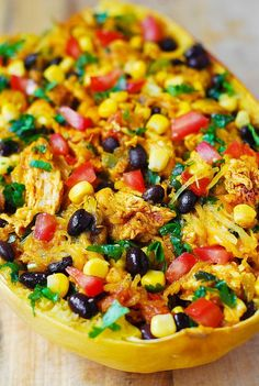 Southwestern Chicken Stuffed Butternut Squash with black beans, bell pepper, tomatoes, corn, green chilies, cheddar cheese, cilantro