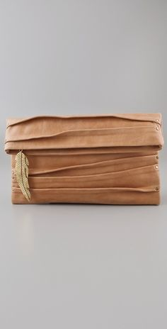 Such a cute clutch and in my favorite leather color right now..COGNAC!!