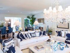 Big American Hamptons style home-I like the pillows with the Hawaiian quilt look.