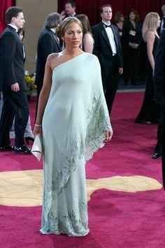 50 Amazing Oscar Looks We're Still Obsessed With #refinery29  http://www.refinery29.com/2015/02/82170/best-oscar-red-carpet-photos#slide-38  Jennifer Lopez, 2003  A mint-green Valentino dress helped Lopez channel Elizabeth Taylor.