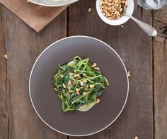 Tender wilted spinach in a tangy Dijon mustard sauce topped with toasted pine nuts.