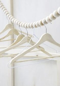 Fuers Heim Snake clothes rail - This hanging wooden bead garland was designed as clothes line or wardrobe rail. Handmade in Germany from 40 beech wood balls. Clothes Rail, Hanging Clothes, Clothes Line, Clothes Hangers, Clothes Stand, Diy Clothes, Wardrobe Solutions, Bois Diy, Diy Wardrobe