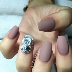 matte nude with floral & bling accent nail. #nudenails
