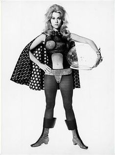 Publicity handout for the 1968 film 'Barbarella,' with Jane Fonda in tights, bodysuit (with 'exposed' right breast plate), cape, boots and holding a plastic helmet. Jane Seymour, Jacob Bannon, Jane Fonda Barbarella, Romain Gary, Francois Truffaut, Space Outfit, Retro Futuristic, Futuristic Motorcycle, Actrices Hollywood