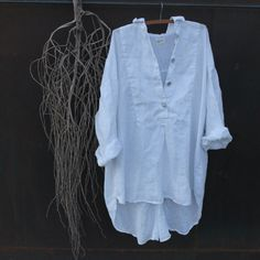I love this shirt, it is a large size, designed for medium to extra large, made from the best shirt linen I could find and is to be worn loose. It looks great with bloomers,jeans,a light silk slip or over your swimmers in the summer time. This shirt is made in a little village in Indonesia and is ready to ship   Measurements Shoulder to Shoulder 26inches  Bust 61inches  Front Length 331/2inches  Back Length 361/2inches  Free Shipping with in Australia International Shipping $14 USD