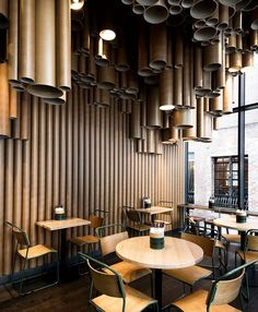 a cardboard tubing light feature and installation can be seen in techne s grill d restaurant interiors. via- interior, design, style Interior Design Blogs, Cafe Interior, Interior Design Inspiration, Interior Photo, Bar Restaurant Design, Luxury Restaurant, Restaurant Lighting, Restaurant Interiors, Restaurant Restaurant