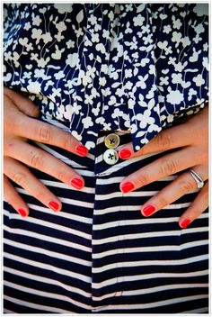 Navy-striped shorts and red nails