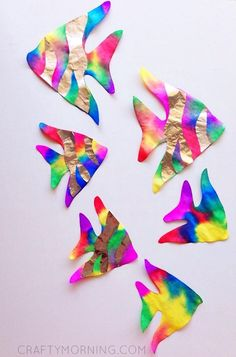 Coffee filter rainbow fish with foil stripes - pretty ocean themed kids craft idea