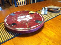 Yard Sale find - old wooden lazy susan - Tole painted and now it makes a great center hot plate for the table!