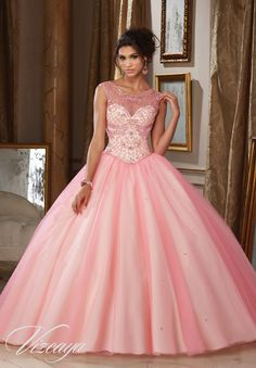 Quinceanera Dresses by Morilee designed by Madeline Gardner. Tulle Quinceañera Ballgown with Intricately Beaded Illusion Neckline. Matching Stole included.