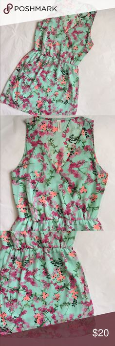 Floral Mint Dress!! Peppermint Brand dress! Made in the USA! Size Large! Beautiful mint green dress with pink and bright orange flowers! Elastic waist! V neck! Polyester! Very boho chic! 34 inches long. Bust 18 inches across. Peppermint Dresses