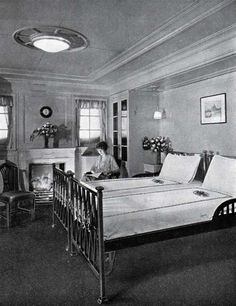 A typical First Class Stateroom with Fireplace on the S.S. Leviathan of the United States Lines circa 1923. Nothing could be more charming than this room with soft gray walls, pomegranatin curtains and bedspreads, black and beige carpet.