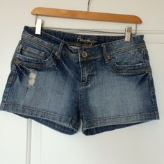 Distressed Denim Shorts Intentionally distressed shorts. 98% cotton, 2% spandex. Listed as size 9 Amethyst Jeans