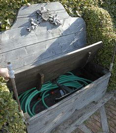 Don't let your garden hose spring a leak! Empty it of water and keep it safe from the elements. (Remember to turn off outdoor water sources.) A hose pot or storage bench helps keep it neat.    - HouseBeautiful.com