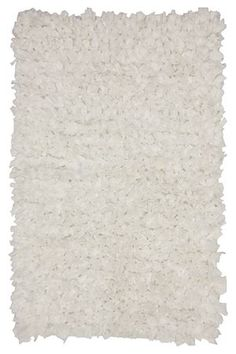 """This woven ruffle rug is made with a blend of cotton and polyester and has a shaggy look that will add interest and texture to your baby's nursery. Measures 70x110cm.<BR><BR><b class=""""descTitle"""">Dimensions:</b><BR>L110xW70 cm<BR><BR><b class=""""descTitle"""">Fabric Content:</b><BR>100% Cotton<BR><BR><b class=""""descTitle"""">Wash Care:</b><BR>Gentle cycle cold wash"""