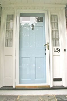 Home Exterior : Wonderful White Painted Wooden Door Frame With Grey Curtain In Small Thin Window And Double Layered Door With Glass Door And Pale Blue . White Front Door, House, Painted Front Doors, Doors, Yellow Doors, New Homes, Glass Storm Doors, House Exterior, Glass Front Door