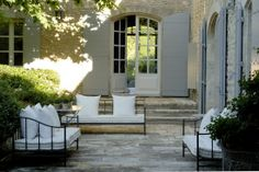 French farmhouse al fresco patio outdoor living stone house wooden shutters Outdoor Rooms, Outdoor Gardens, Outdoor Living, Outdoor Decor, Outdoor Seating, Patio Design, Exterior Design, Stone Exterior, Courtyard Design