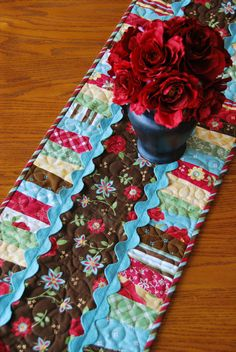 Idea for strips of fabric  table runner with rick rack