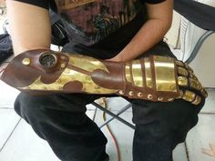 A custom hand made gauntlet with brass plating and compass made by Steam Generation  Made using 3mm veg tan leather, brass rivets / screws / buckles / plating, clients compass