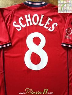 Relive Paul Scholes' 2002 World Cup against Argentina with this vintage Umbro England away football shirt.