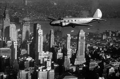 Boeing Model 247D in flight over New York City. The Model 247 ushered in the age of speed, reliability, safety and comfort in air travel. 1935.
