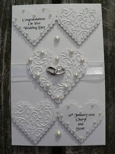 I was asked to make this wedding card by a relation for a wedding they are going to soon.  I used pearl card to make it and added spellbind...