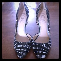 Bcbg black and white snakeskin heels Awesome condition, worn twice, 4.5 inch heel like new BCBG Shoes Heels