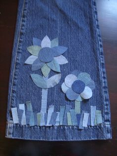 super cute applique jean flowers, I wouldn't do it on pants but I think they would be SUPER cute on a bag!