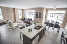 Porchlight Developments is a new home builder that focuses on building amazing communities in Regina and Winnipeg New Home Builders, Living Area, New Homes, Bright, Building, Kitchen, Home Decor, Cuisine, Homemade Home Decor