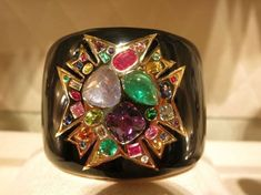 "VERDURA MALTESE 75th ANNIVERSARY CROSS CUFF BRACELET~ In addition to the vintage pieces on display a brand new limited edition bejeweled cuff bracelet, named ""Theodora,"" was created for the 75th anniversary. The bracelet's Maltese Cross decoration is based on two brooches that were the very first collaboration between Fulco Verdura and Coco Chanel that were gifted to Diana Vreeland, who famously wore them on her signature turban."