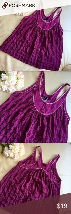 Plum purple French Connection racerback tank Plum purple FCUK French Connection racerback tank, features amazing detail fabric, layered hem, cute button detail at neckline, and satin trim. Condition is used and seen in the fabric, please see photos. Lots of life left in this top and it is one of my all time favorites (which is why I held onto it so long after I no longer fit it)! Great ready to wear style for weekends or under a blazer for work. You'll love this top! French Connection Tops…