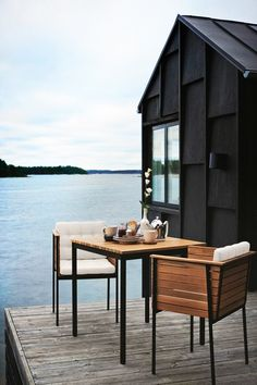 Small table on a deck next to a lake